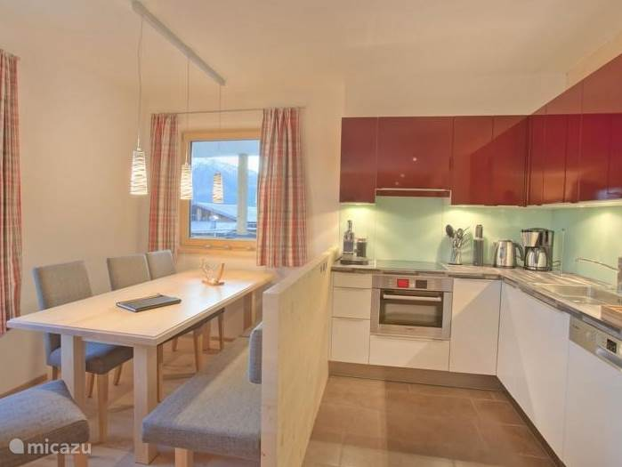 Beautiful kitchen in apartment Kristall. The kitchen has a microwave, induction hob, dishwasher and Nespresso machine.