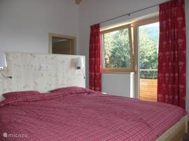 Spacious bedroom with balcony and ensuite bathroom apartment in Emerald.