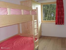 Apartment Emerald also has a bedroom with bunk beds.