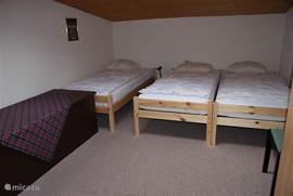 The 3 bedroom, with wardrobe and wash basin and toilet.