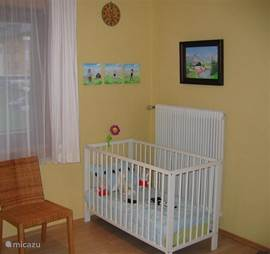 A cot (120cm) long is located in bedroom 3. In addition we have a stair gate available that fits the doorway.