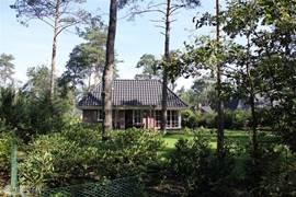 Tuin vanuit het bos
