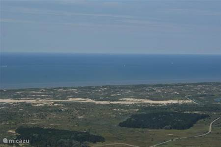 Luchtfoto's richting strand