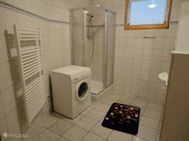 The large bathroom has a shower with sink and you can charge the washing machine.
