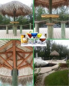 Juli 2013- een bar gemaakt onder de Tiki hut. Sfeervol verlicht en 'the place to be' tijdens de avonden. Zet het bose systeem aan en je hebt je eigen favoriete muziek.