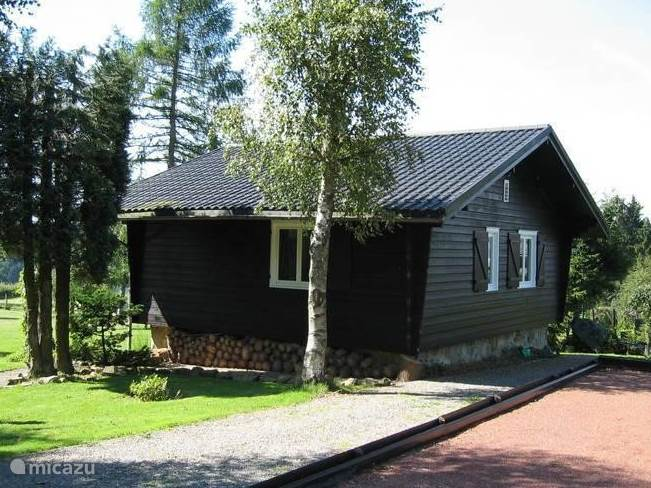 View Chalet in summer on the side of the entrance