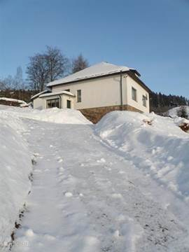Our house in winter. Parking spaces are located at the start of the compound