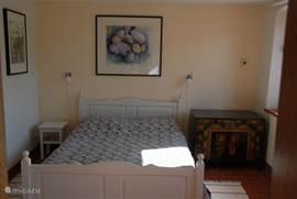 De slaapkamer op de begane grond