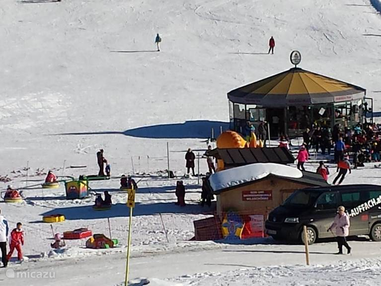 Children Whirligig with big bands of the ski school at the middle station of the Schatzbergbahn
