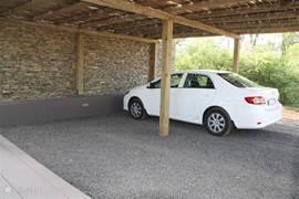Een eigen carport voor de vakantiewoning