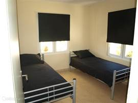 The 3rd bedroom with 2 single bed