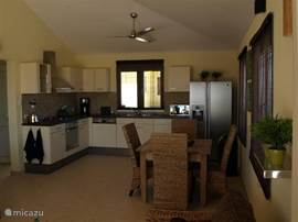 The spacious kitchen with dining area