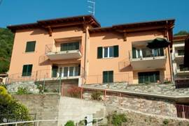 The front view of the Residenza Romina. Our apartment is right with the green parasol.