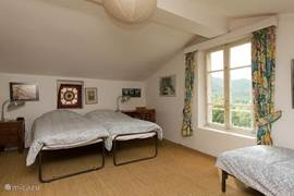 Bedroom 2 (first floor) with three single beds and beautiful views over the valley.