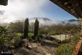 View across the valley from the veranda. Early in the morning already sit in the sun.