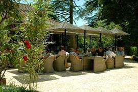 Relax in the shade of the parasols on outdoor terrace restaurant 3XTROIS.