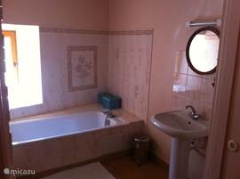 Bathroom with a large bath
