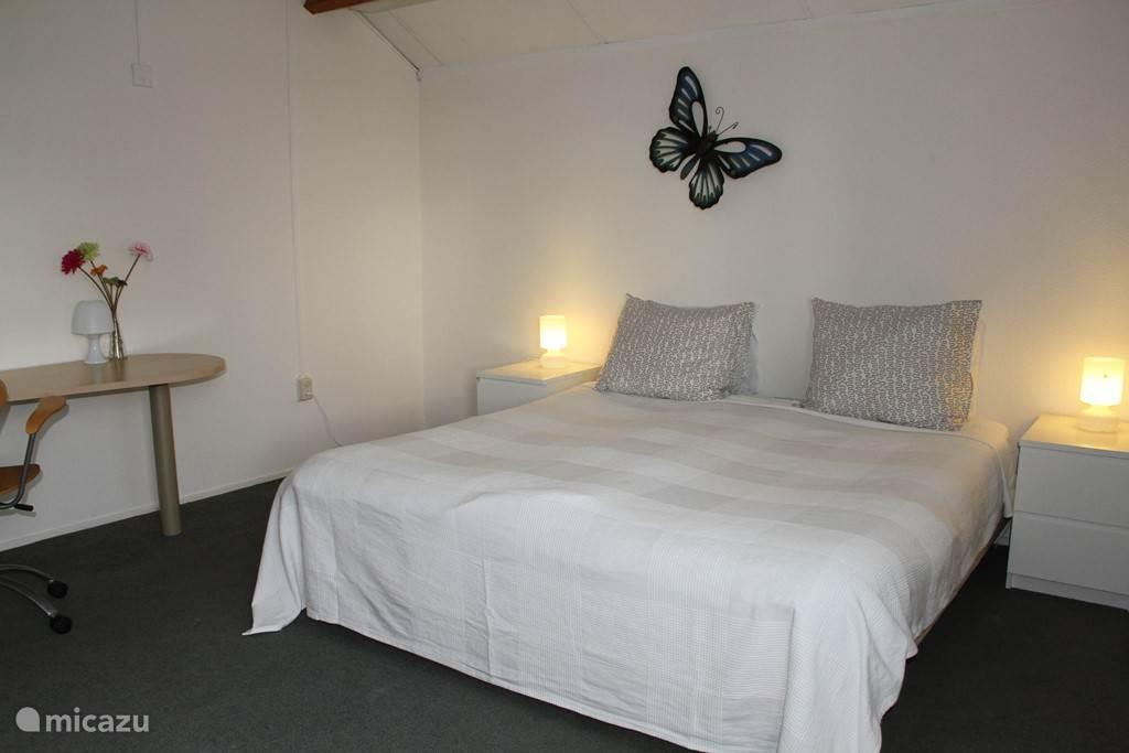 Vlinder kamer met uitzicht op het Veerse Meer en de tuin