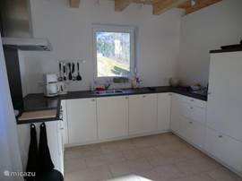 The kitchen has an electric hob, oven, dishwasher and fridge freezer.