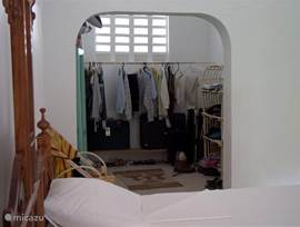 Dressing room ensuite to the bedroom.