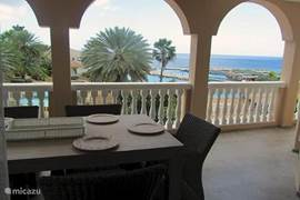 The spacious porch of the penthouse apartment overlooking the pool, the Seaquarium and the Caribbean Sea.