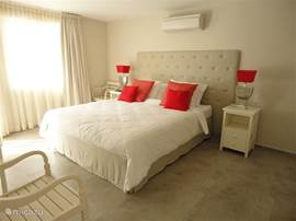 Master bedroom with air conditioning, door to the porch, king size bed (1.80 * 2.20 cm), flat screen TV and DVD player.