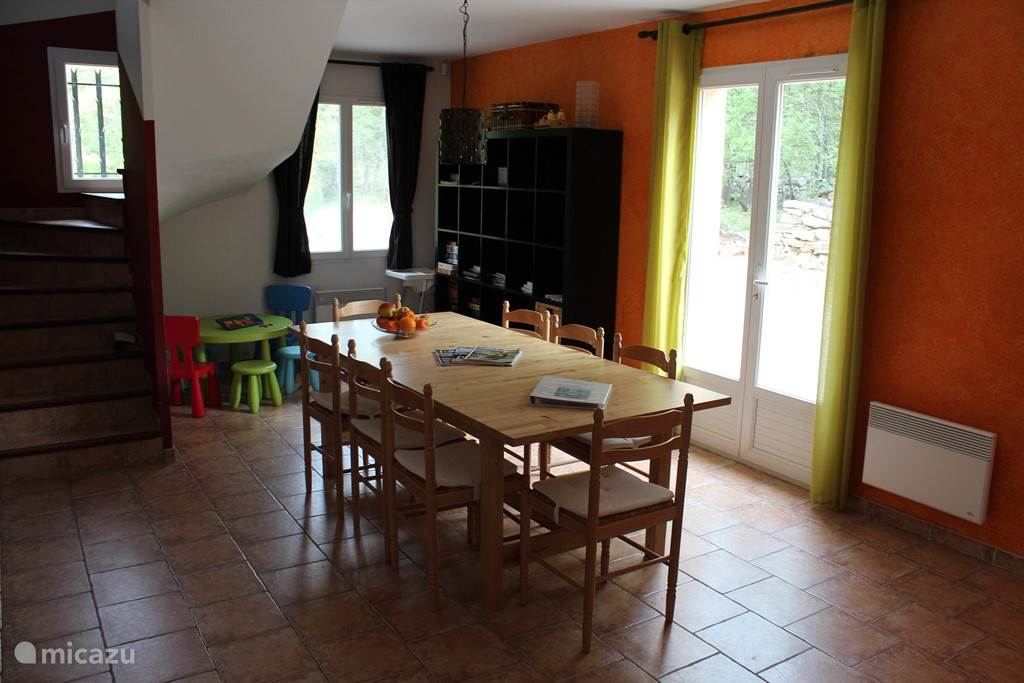 Spacious dining area with table for 12 people. There is also a separate children's table with 4 chairs and chair for the dining table.
