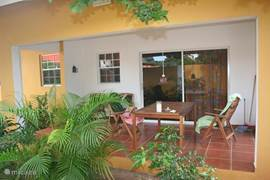 porch of the 3 bedroom apartment. it has 2 bedrooms and 2 bathrooms with a spacious living room. privacy on the porch. mail us for the price.