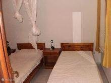Slaapkamer meT 1 persoonsbedden.