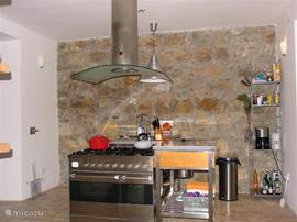Kitchen with dishwasher, fridge/freezer, gas stove with 2 ovens (gas and electric), coffee machine, kettle, toaster, etc. Fully equiped with pots, pans, kitchen tools and beautiful serving dishes.