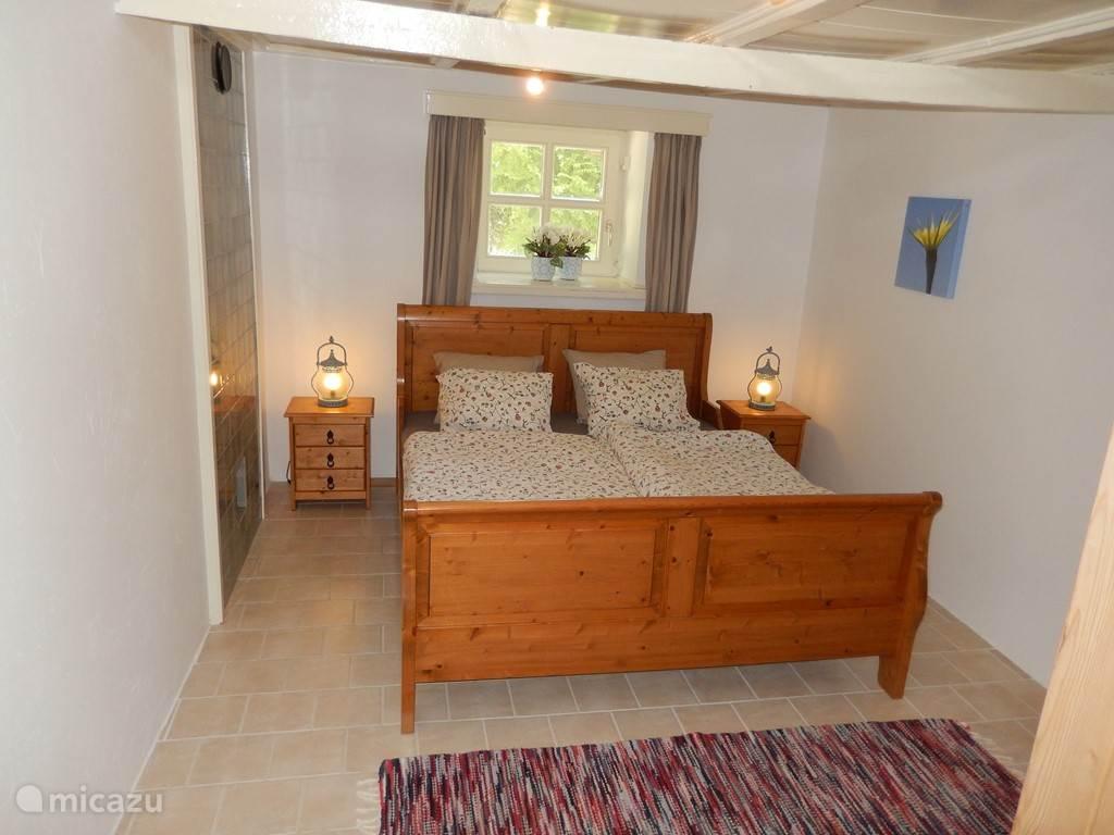 Riante slaapkamer voor twee personen.