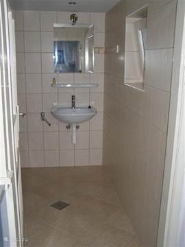 The bathroom is new and spacious. Here are a shower, sink and toilet.
