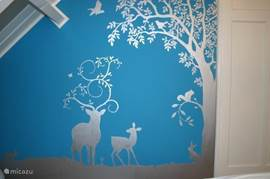 Muurschildering in slaapkamer