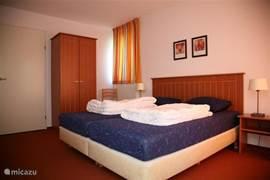 De grote slaapkamers hebben twee heerlijke hotelboxsprings in iedere kamer.