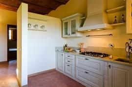 De keuken met granieten werkblad