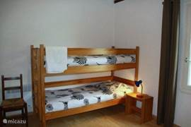 2nd bedroom with bunk beds and a rollaway combination, bedside tables and a wardrobe.