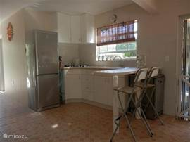 The kitchen provides all the comforts you would expect, including a five-burner hob, large American refrigerator, dishwasher, kettle, toaster and coffee maker. Of a luxury villa