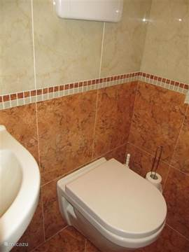 The bathroom is fully tiled and also delicious with shower