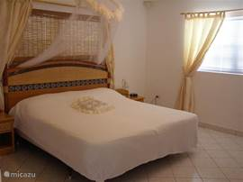 The master bedroom is a spacious bedroom with a private bathroom.