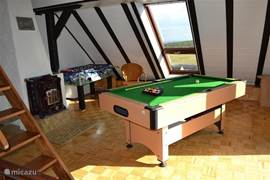 Game room upstairs with pool table and table football.