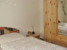 Bedroom 2 has a 2 door wardrobe with full length mirror. The bedroom is approximately 18 square meters