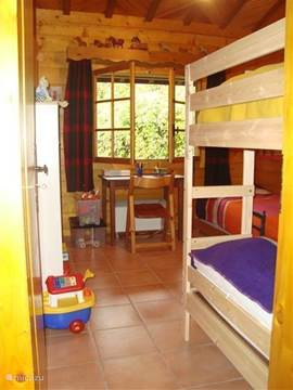 the children's bedroom with bunk bed and 2 pull out beds