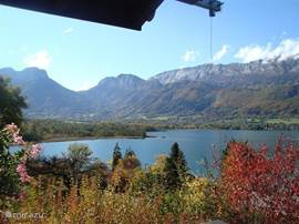 view from the balcony to the nature reserve 'Bout du Lac and the mountains of the Bauges