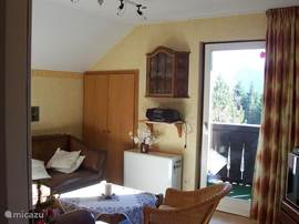 Living room, equipped with satellite TV and access to the balcony.