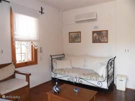 woonkamer 1e etage met groot terras