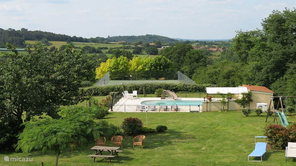 view from the terrace to the pool and tennis court, behind the Dordogne valley
