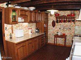 The kitchen has plenty of storage and crockery, for a grand dinner!