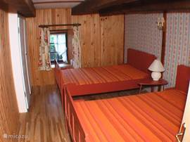 Bedroom 3 with 2 doubters and large built in wardrobe.