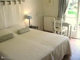 The 2nd double bedroom also with en suite bathroom and patio doors to garden terrace.