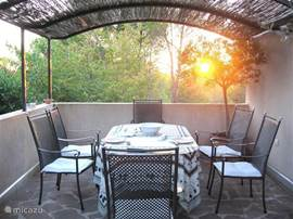 Outside terrace adjoining living / dining area and the sunset.